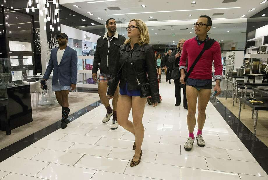 Participants of the No Pants BART Ride Day walk through Bloomingdale's after exiting the Powell Street BART station into Westfield Centre in San Francisco, Calif., on Sunday, January 8, 2017. The group gathered at the Embarcadero station and rode together without their pants on to Powell Street. The annual event was organized by the group Improv Everywhere. Photo: Laura Morton, Special To The Chronicle