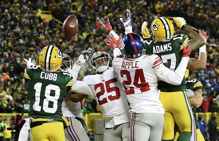 The Packers' Randall Cobb (18) is at the right place at the right time as he hauls in a 42-yard Hail Mary touchdown pass from Aaron Rodgers in the second quarter of Sunday's NFC wild-card win over the Giants. Photo: Stacy Revere, Stringer / 2017 Getty Images