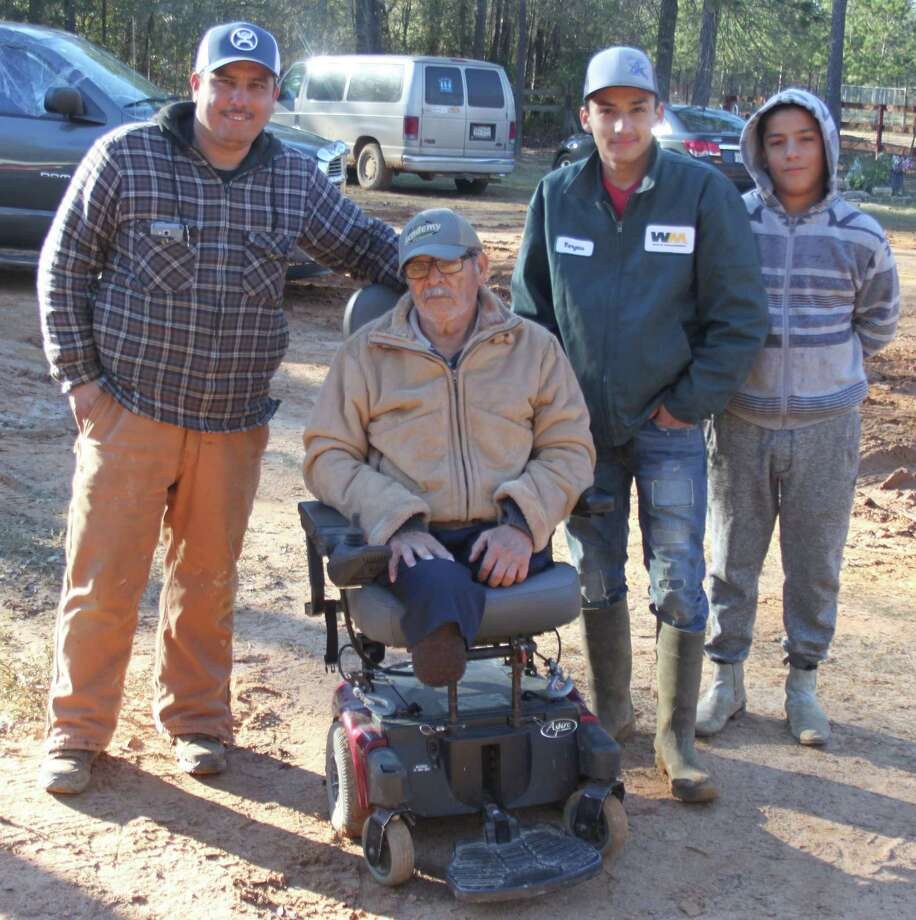 Abel Juarez (second from left) sits comfortably in his new motorized chair thanks to his friend Leo Vargas (left) who reached out to find help. The chair was provided by Keith Field (not pictured). Left to right are Vargas, Juarez, Vincente Vargas and Jose Gonzales. Photo: Jacob McAdams