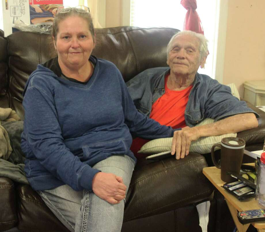 Sherrie Bush (left) helps to take care of her veteran father Leo Runnels (right), who is currently confined to his home without a proper ramp to leave his home in a wheelchair. Photo: Jacob McAdams