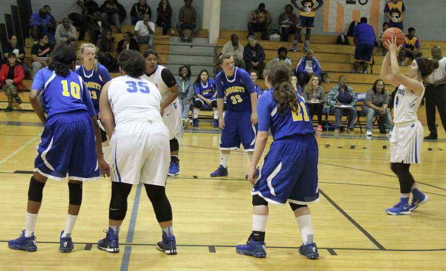 Cora Truelove (right) of the Shepherd Lady Pirates launches the ball for a free throw. Photo: Jacob McAdams