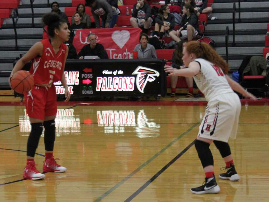 A Huffman Lady Falcon (right) defends against Cleveland Lady Indian Simran Mayfield (left). Photo: Jacob McAdams