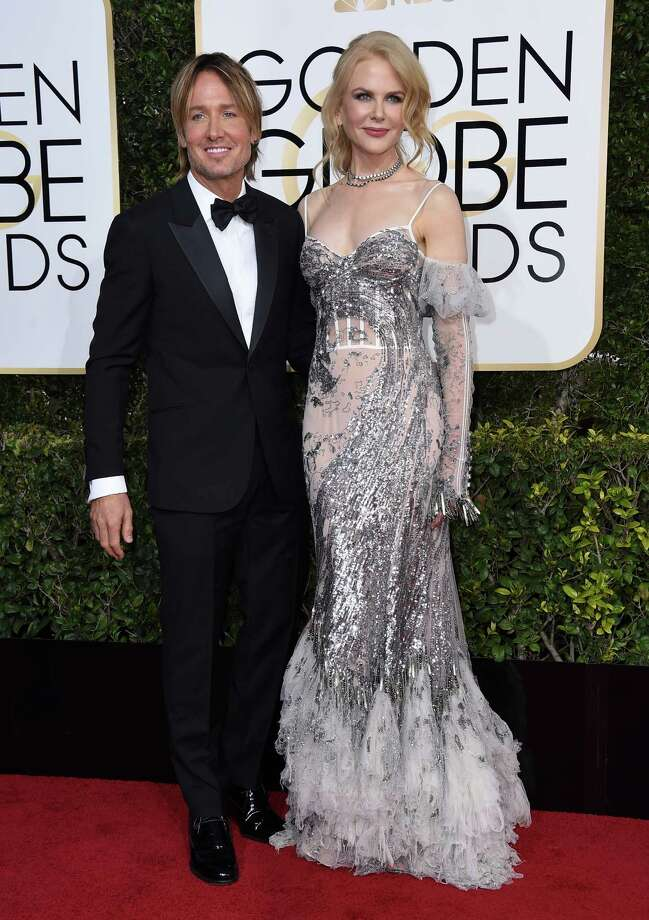 Keith Urban, left, and Nicole Kidman arrive at the 74th annual Golden Globe Awards at the Beverly Hilton Hotel on Sunday, Jan. 8, 2017, in Beverly Hills, Calif. (Photo by Jordan Strauss/Invision/AP) Photo: Jordan Strauss, Jordan Strauss/Invision/AP / 2017 Invision