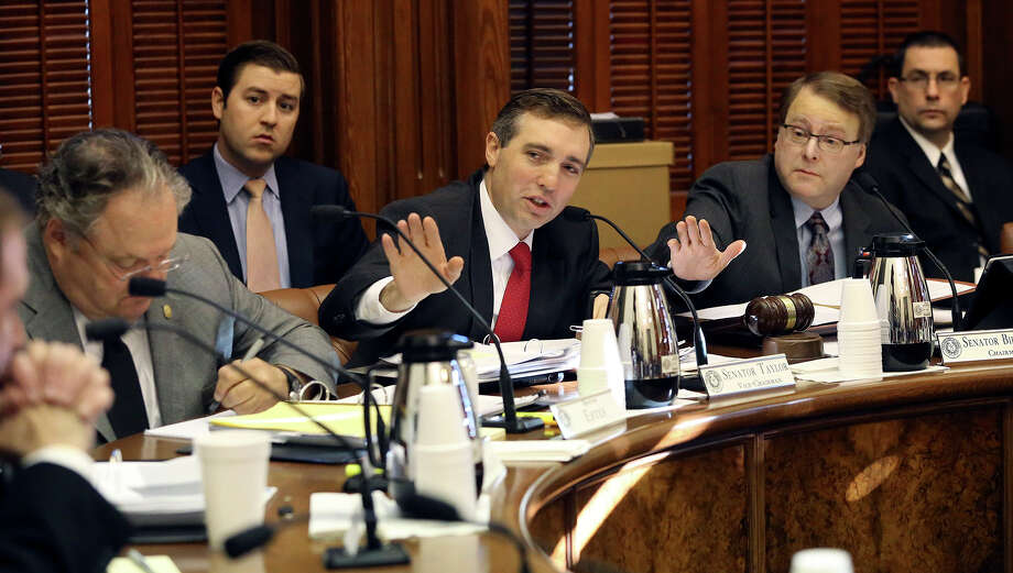 State Sen. Van Taylor (center), a Plano Republican, is author of the ethics reform bill that was finally passed Tuesday by the Texas Senate. Photo: Tom Reel