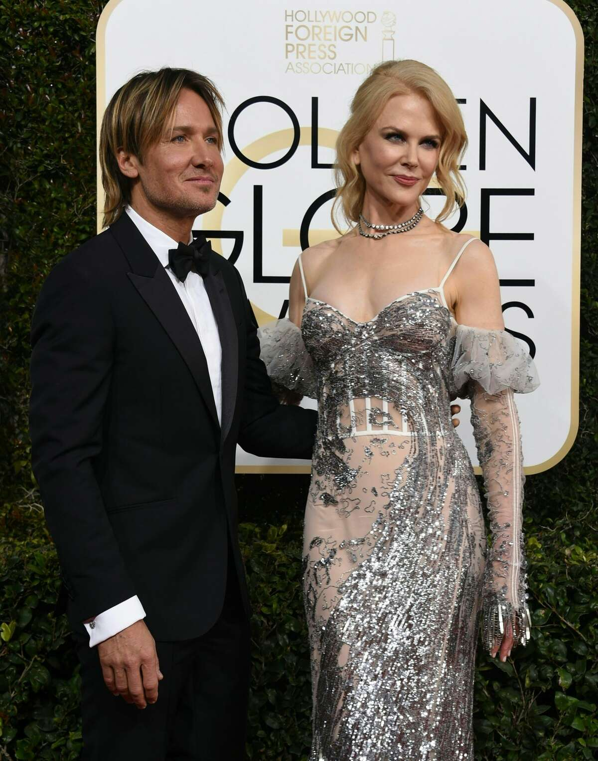 Nicole Kidman (R) and Keith Urban arrive at the 74th annual Golden Globe Awards, January 8, 2017, at the Beverly Hilton Hotel in Beverly Hills, California.