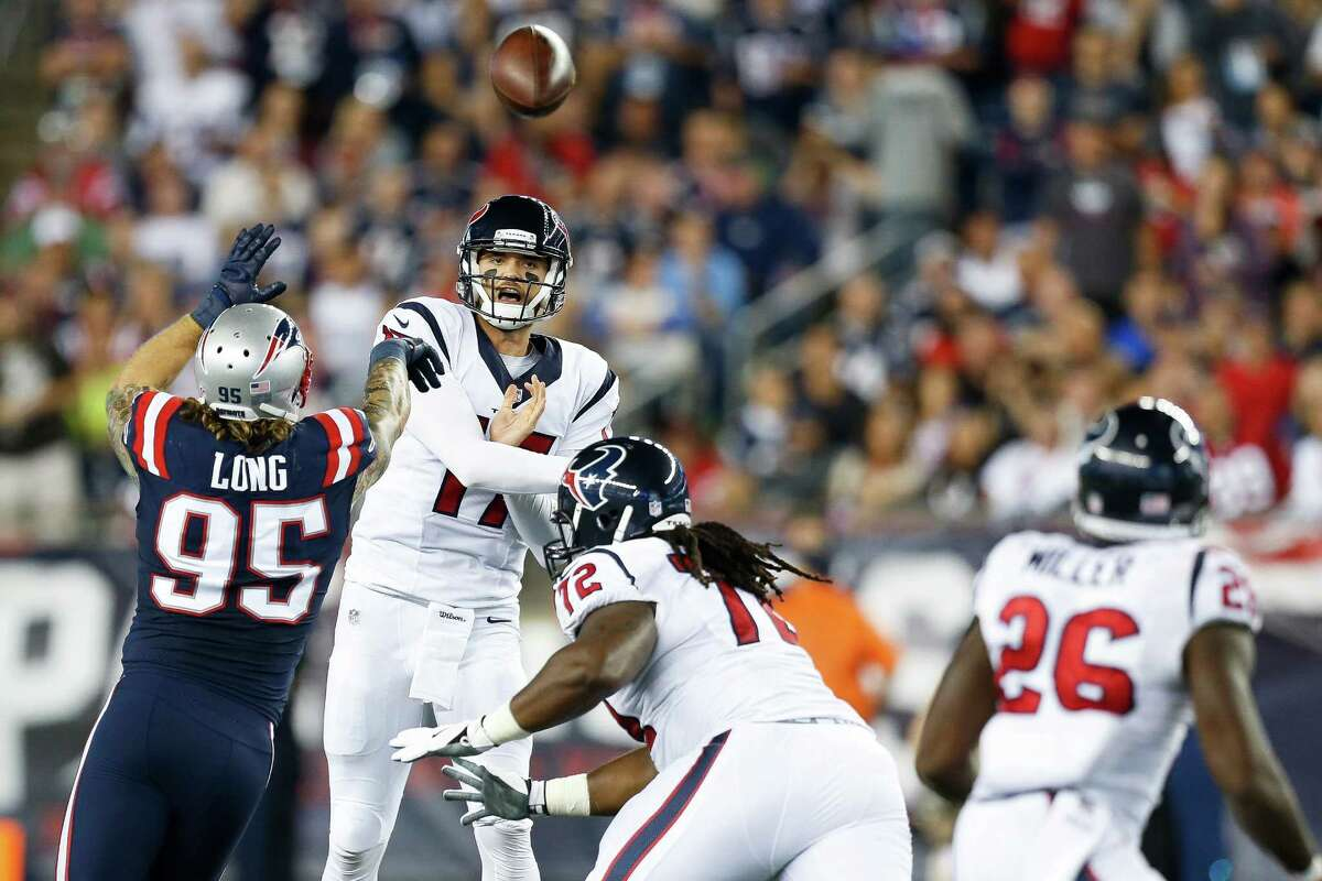 Quarterback Brock Osweiler (17) delivers a pass over Patriots defensive end Chris Long (95) during the second quarter of the Texans' loss early this season at Gillette Stadium, where the Texans are 0-4.