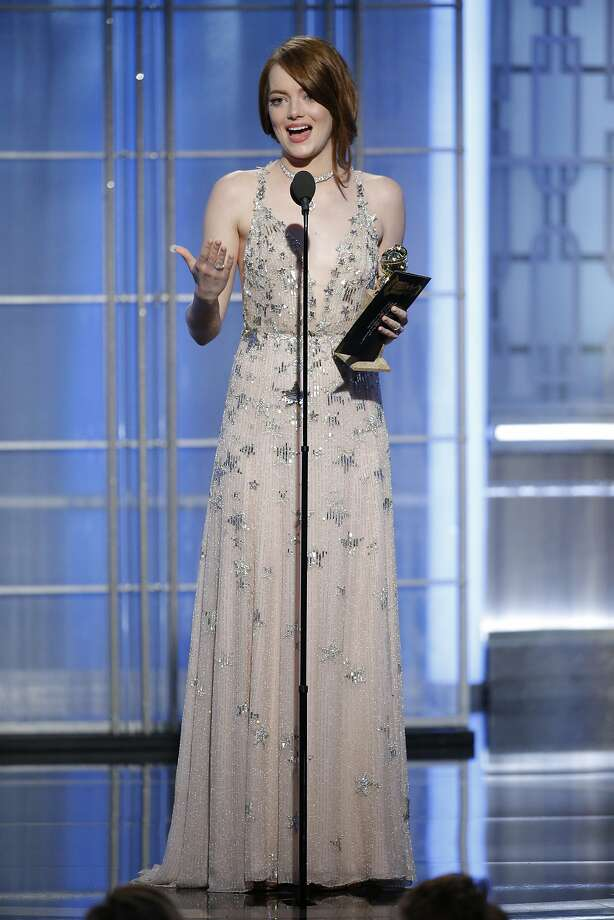 "This image released by NBC shows Emma Stone with the award for best actress in a motion picture comedy or musical for her role in ""La La Land"" at the 74th Annual Golden Globe Awards at the Beverly Hilton Hotel in Beverly Hills, Calif., on Sunday, Jan. 8, 2017. (Paul Drinkwater/NBC via AP) Photo: Paul Drinkwater, Associated Press"