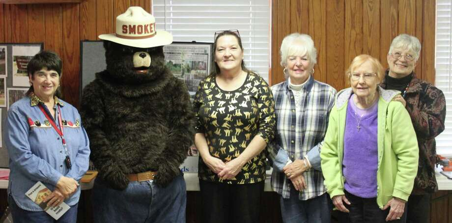 Members of the San Jacinto County Master Gardenerspose with Smokey Bear after hearing a presentation on Jan. 6 from the United States Forest Service and the Sam Houston Trails Coalition. Left to right: Manette Farber, Smokey Bear, Pattie Leslie, Carrol Cornell, Kathiy Sinclair and Wanda Gardner. Photo: Jacob McAdams