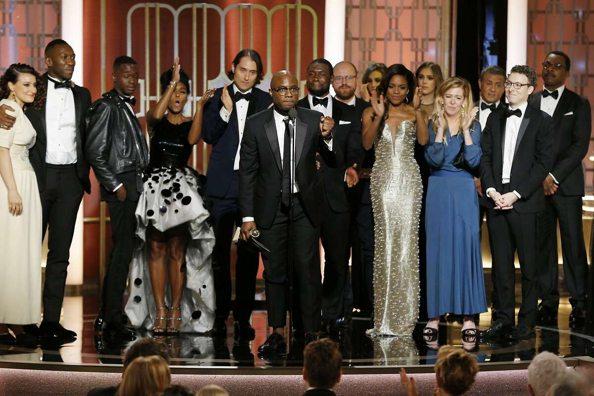 """BEVERLY HILLS, CA - JANUARY 08: In this handout photo provided by NBCUniversal, director Barry Jenkins and the cast and crew of """"Moonlight"""" accept the award for Best Motion Picture - Drama for """"Moonlight"""" onstage during the 74th Annual Golden Globe Awards at The Beverly Hilton Hotel on January 8, 2017 in Beverly Hills, California. (Photo by Paul Drinkwater/NBCUniversal via Getty Images)"""