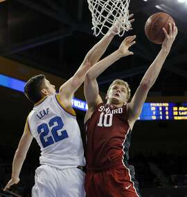 UCLA forward TJ Leaf (22) defends as Stanford forward Michael Humphrey (10) shoots in the first half of an NCAA college basketball game in Los Angeles on Sunday, Jan. 8, 2017. UCLA won, 89-75. (AP Photo/Reed Saxon)
