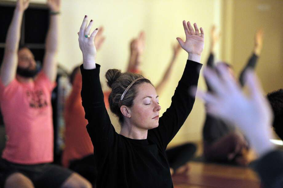 Mo Tracey participates in a yoga session run by Dee Dussault of Ganja Yoga during a private Cannaisseur brunch in San Francisco. Photo: Carlos Avila Gonzalez, The Chronicle