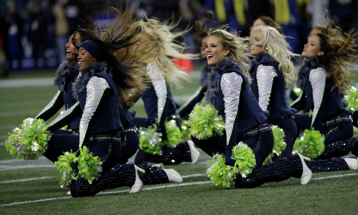 Seattle Seahawks Sea Gals cheerleaders perform before an NFL football NFC wild card playoff game against the Detroit Lions, Saturday, Jan. 7, 2017, in Seattle. (AP Photo/Elaine Thompson)