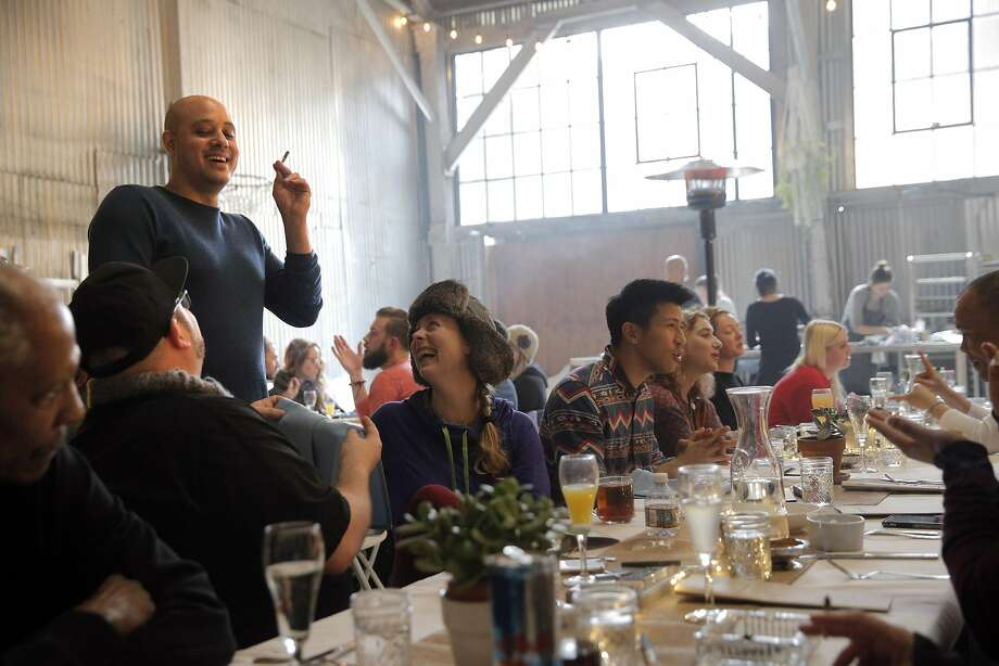 """The Cannaisseur Series, co-founded by Ryan Bush, who acts as host (seen standing), features four-course gourmet meals and cannabis to smoke or vape, on a monthly basis. The meals are held in San Francisco. At the first gathering of 2017, nearly three dozen guests paid $149 per person for the New Year's themed """"Fresh Start Yoga Brunch"""" on Jan. 8. Photo: Carlos Avila Gonzalez, The Chronicle"""