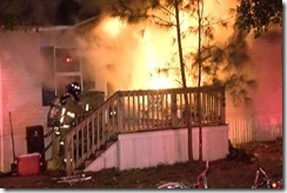 A family and their pets escaped unharmed as flames swept a mobile home about 3 a.m. Monday, Jan. 9, 2017, on Orion Lane near Texas 105 in Cut and Shoot area just west of Conroe in Montgomery County. (Montgomery County Police Reporter)