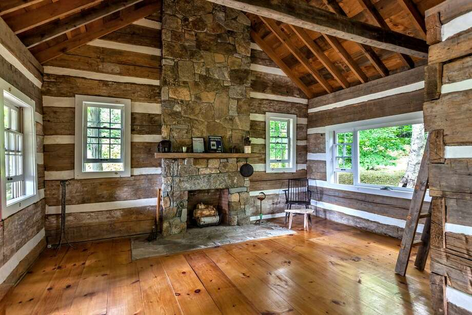 23 Kane Mountain Rd, Kent, CT 06757  4 beds 4 baths 3,468 sqft  Features: Authentic Civil War-era cabin, barn, beamed ceilings, stone fireplaces  View full listing on Zillow Photo: Zillow
