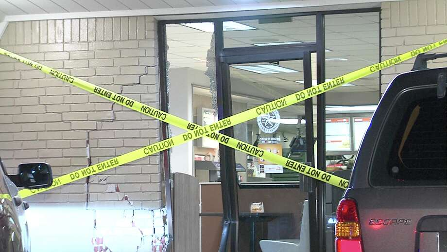A man crashed his pickup into a Whataburger on the West Side on Jan. 9, 2017, before fleeing the scene in his vehicle. Photo: Ken Branca