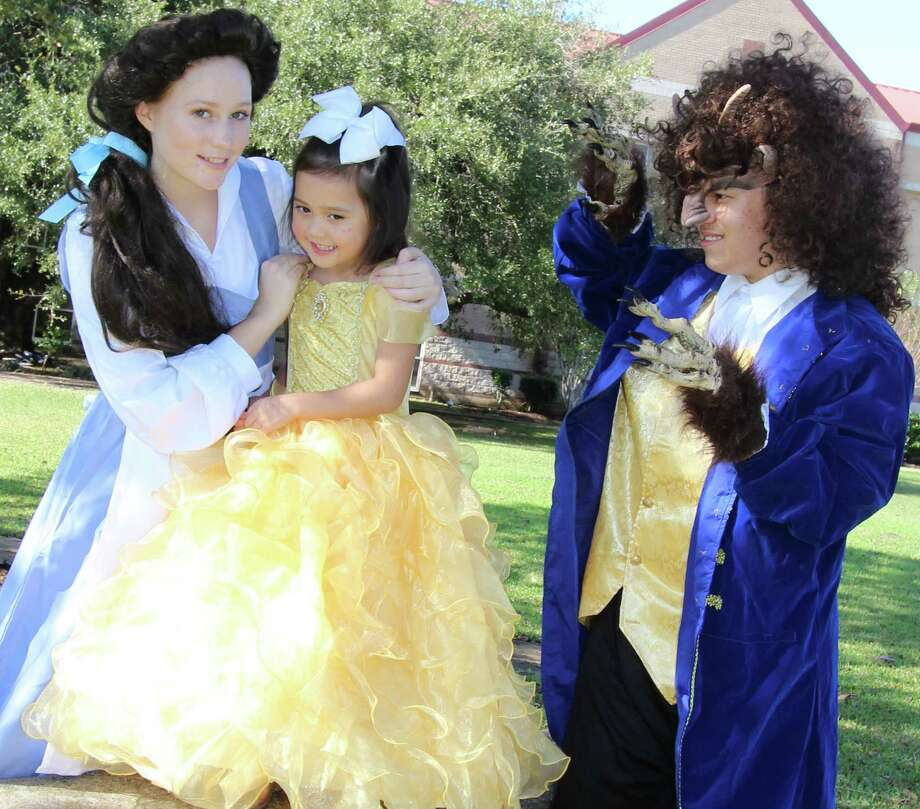 "Allison Quach, 5,  is eager for the Jan. 21 ""princess party"" event that will precede Alvin High School's production of ""Beauty and the Beast."" The party will include appearances by show cast members, including Suzanne Finger, left, who plays Belle, and  Ben Miller, who portrays the Beast. Photo: Don Maines"
