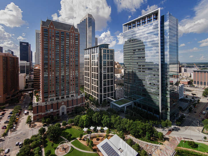 5 Houston Center, at center, has been sold as part of a $272 million package of Houston office properties as its former owner, Columbia Property Trust, Inc., exits the Houston market.