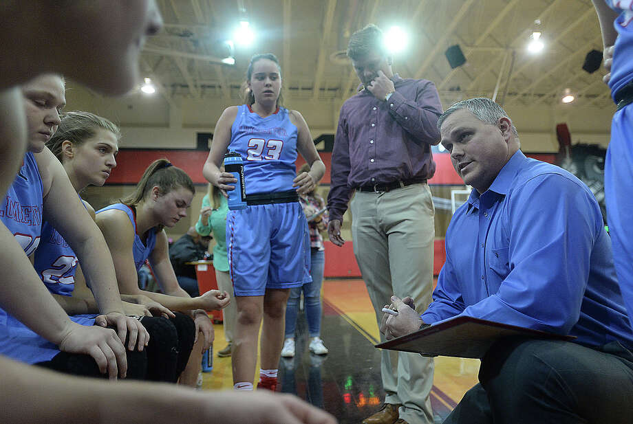 Lumberton girls basketball head coach Jason Sanders strategizes with his team in-between quarters during Friday night's match-up at Port Arthur Memorial. Photo taken Friday, January 6, 2017 Kim Brent/The Enterprise Photo: Kim Brent / Beaumont Enterprise