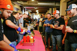 The 2nd Annual Houston BBQ Throwdown will be held on Nov. 20, 2016 at Saint Arnold Brewing Company. Shown: Scenes from 2015 throwdown (the line at the CorkScrew BBQ booth).