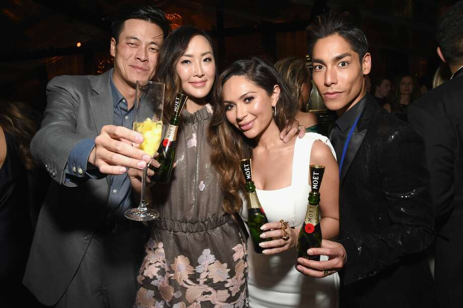 Chriselle Lim and Marianna Hewitt pose with guests at The Weinstein Company and Netflix Golden Globe Party, presented with Moet & Chandon at The Beverly Hilton Hotel on January 8, 2017 in Beverly Hills, California. Photo: Michael Kovac/Getty Images For Moet & Chandon