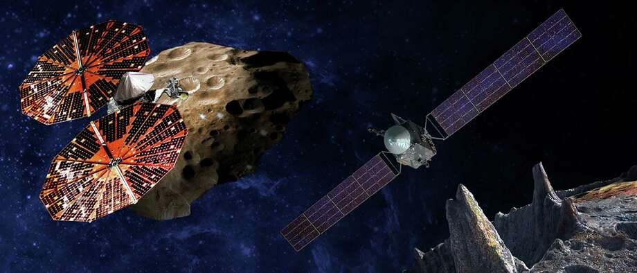 A NASA illustration shows the Lucy spacecraft (left) flying near the Trojan Eurybates asteroid. The mission is scheduled to launch  in 2021. Photo: Getty Images / AFP or licensors