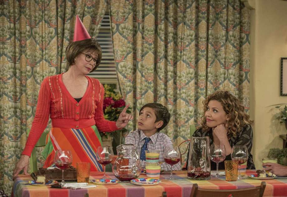 """This image released by Netflix shows Rita Moreno, from left, Marcel Ruiz and Justina Machado in a scene from """"One Day At A Time."""" The series, a remake of the 1970's-80's Norman Lear TV series, centers on a Cuban-American family. It debuts on Netflix on Sunday. (Michael Yarish/Netflix via AP) Photo: Michael Yarish, HONS / Associated Press / Netflix"""