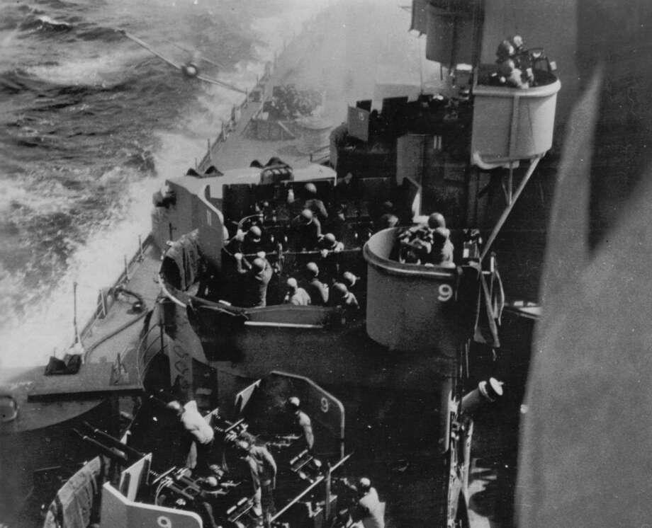 A Japanese Kamikaze is shown just before colliding with the USS Missouri during the Battle of Okinawa in the Pacific Ocean, April 11, 1945.  Recent findings suggest the historic photo was taken by Baker 2nd Class Harold ``Buster'' Campbell, one of the ship's cooks. (AP Photo/Harold Campbell courtesy of Dan Campbell) Photo: HAROLD CAMPBELL, HO / AP / DAN CAMPBELL