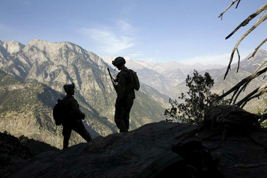 FILE Two Marines on a mountain ridge overlook the Pakistani border near Kamu, Afghanistan, Oct. 27, 2008. (Tyler Hicks/The New York Times) Photo: TYLER HICKS /NYT / NYTNS
