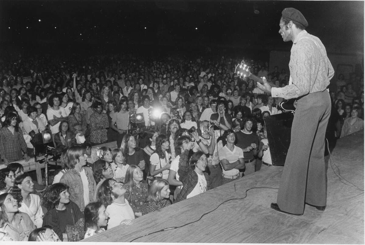 Fans crowd close to the outdoor stage to be near Chuck Berry. July 1974