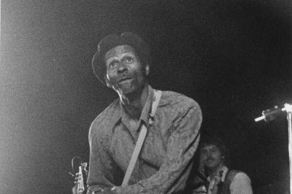 "Chuck Berry begins his ""duck walk."" July 1974"