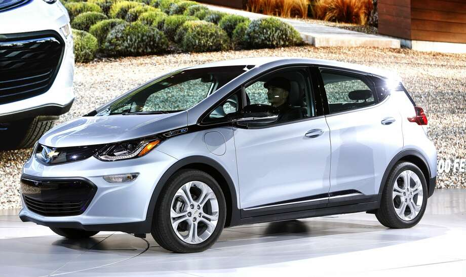 DETROIT, MI - JANUARY 9: The all-electric Chevrolet Bolt EV is shown on stage after it won the Car of the Year Award at the 2017 North American International Auto Show on January 9, 2017 in Detroit, Michigan. Approximately 5000 journalists from around the world and nearly 800,000 people are expected to attend the NAIAS between January 8th and January 22nd to see the more than 750 vehicles and numerous interactive displays. (Photo by Bill Pugliano/Getty Images) Photo: Bill Pugliano/Getty Images