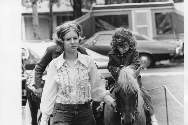 Youngsters ride ponies during Holiday '75 activities. June 1975