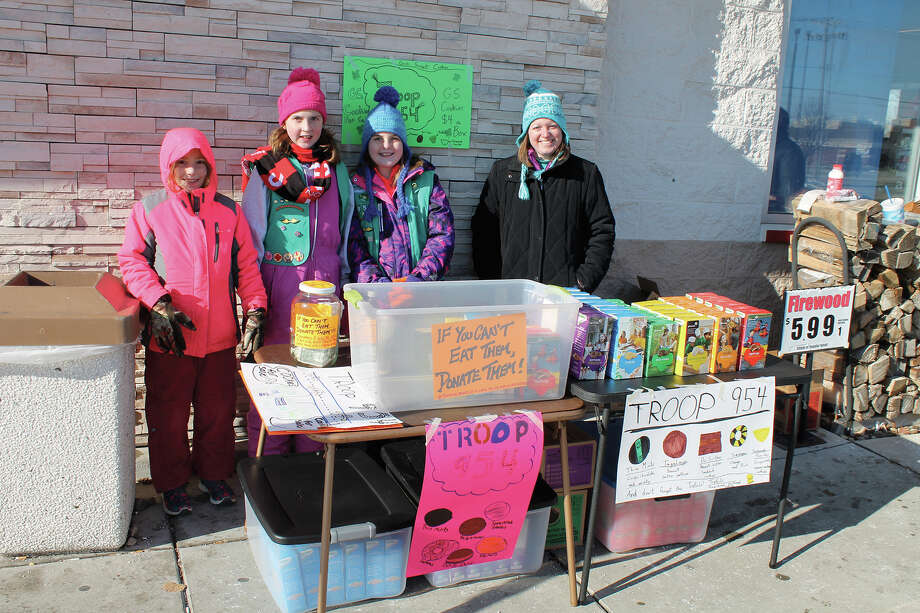 Braving Saturday morning's 15-degree chill, members of Hamel-Worden Junior Girl Scout Troop 954 manned a table outside of the McDonald's/Circle K on Route 157 in Edwardsville to sell their famous cookies. As part of their service project, the girls offered those buying cookies an option to donate a box or two to charity. Photo: Bill Tucker • Intelligencer