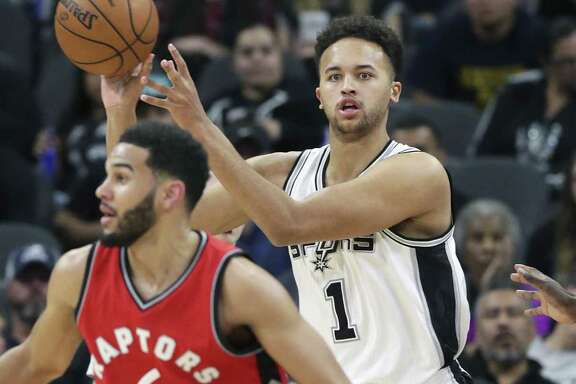 Kyle Anderson lofts a pass out to the front over Cory Joseph as the Spurs play the Raptors at the AT&T Center on January 3, 2017.
