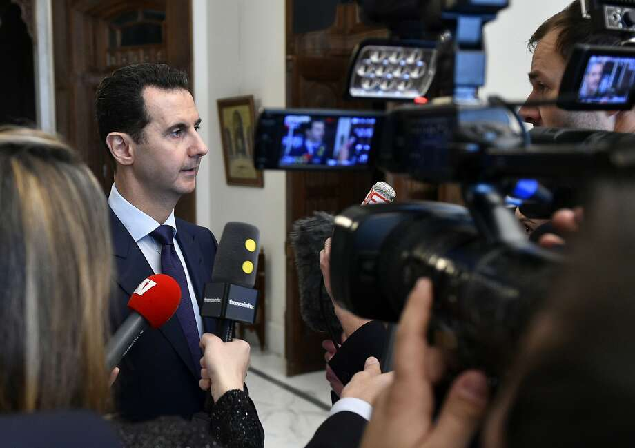 "Syrian President Bashar Assad addresses reporters in Damascus. Assad says he's willing to ""negotiate everything"" at talks brokered by Turkey and Russia set to begin later this month in Kazakhstan. Photo: Uncredited, Associated Press"
