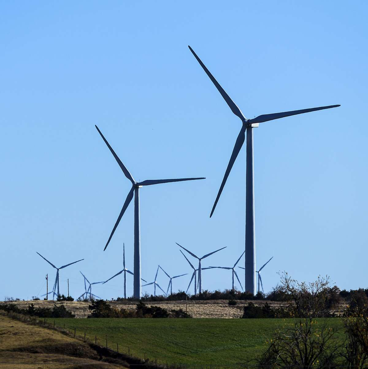 This photo provided by Google shows windmills at a wind farm in Minco, Okla., that provides Google with some of its renewable energy. Google says it believes that beginning in 2017, it will have amassed enough renewable energy to meet all of its electricity needs throughout the world. (Tim Boyles Photography/Google via AP)