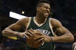 Milwaukee Bucks' Giannis Antetokounmpo reacts in a play against the Oklahoma City Thunder during the second half of an NBA basketball game Monday, Jan. 2, 2017, in Milwaukee. (AP Photo/Jeffrey Phelps)