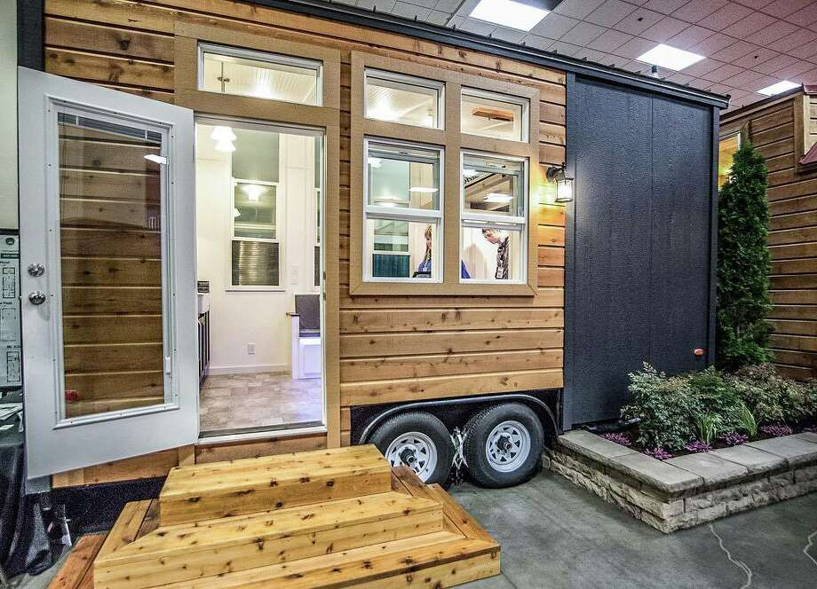 The Little Tahoma Peak model tiny home from Tiny Mountain Houses. The base price is $39,995, but the model shown here is $57,510. It's 210 square feet. Photo: Tiny Mountain Homes/Courtesy