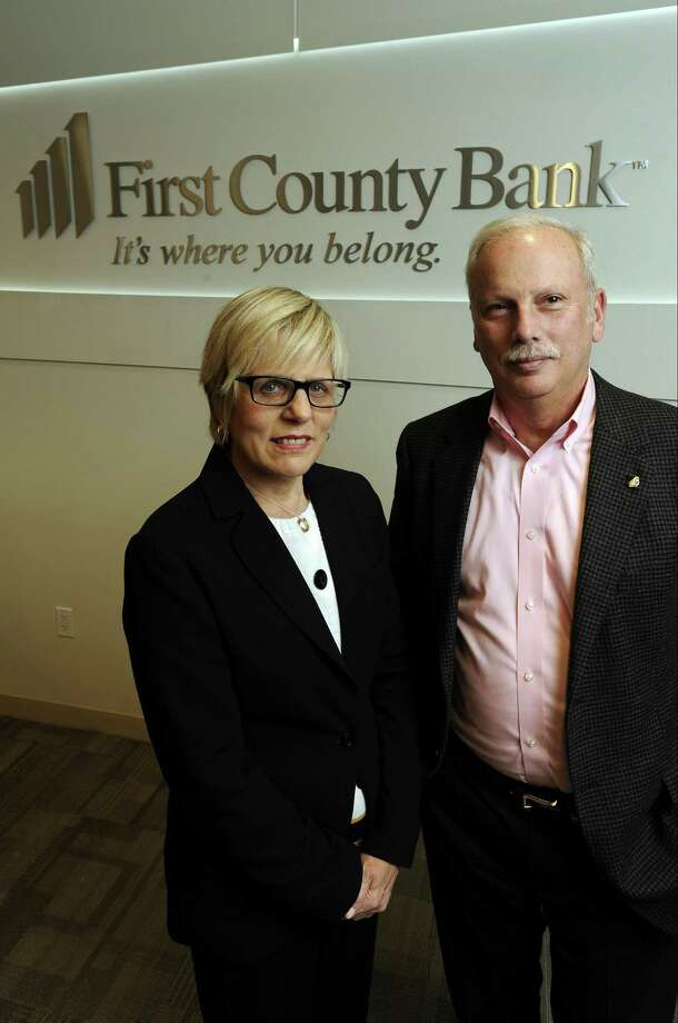 Karen Kelly, First County Bank's chief marketing officer and First County Bank Foundation's vice president, and Reyno Giallongo Jr., First County Bank's chairman and CEO and First County Bank Foundation's president, gather at their company's offices at 3001 Summer St. in Stamford. Photo: Matthew Brown / Hearst Connecticut Media / Stamford Advocate