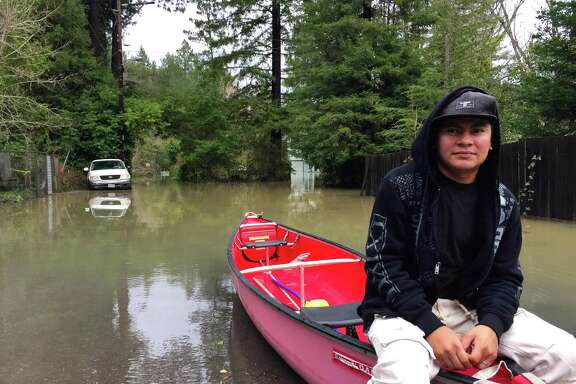 Victor Menjivar had to leave his Guerneville apartment complex by boat Monday morning because of flooding along the Russian River.