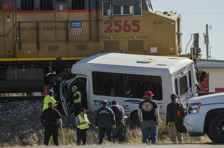 Midland police and fire respond to a small TRAX bus left the roadway Monday 01-09-17, traveling East on Business 20 in the 5700 block and struck a train injuring multiple passengers and the driver. Tim Fischer/Reporter-Telegram Photo: Tim Fischer/Midland Reporter-Telegram
