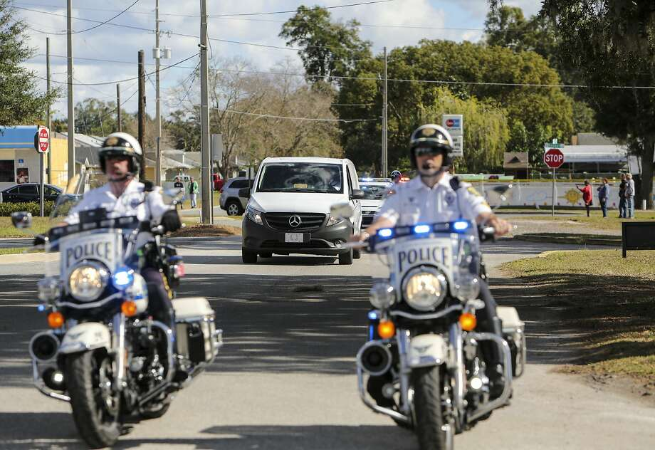 Law enforcement officers in Orlando escort the body of a deputy who died in a crash during the search for the gunman who killed a local police officer. Photo: Jacob Langston, Associated Press