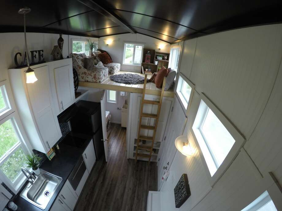 The customized version of the Castle Peak model tiny home from Tiny Mountain Houses. The base price is $55,995, but the model shown here is $81,265. It's between 314-335 square feet, depending on which size model you choose. Photo: Tiny Mountain Homes/Courtesy