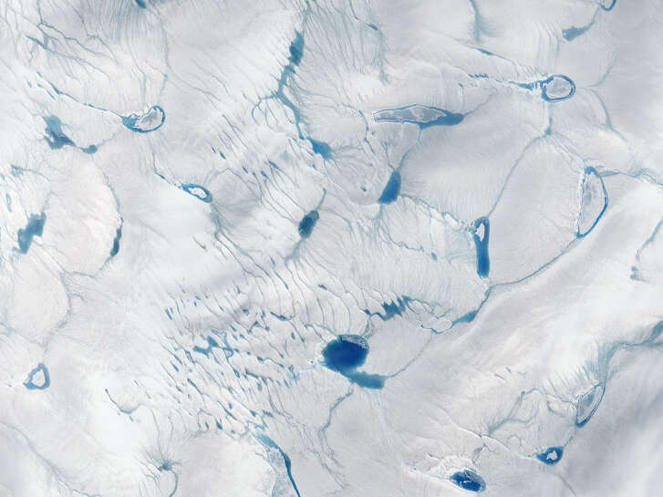 Exceptionally early ice melt, Greenland    - After      Date: June 15, 2016   Source: NASA