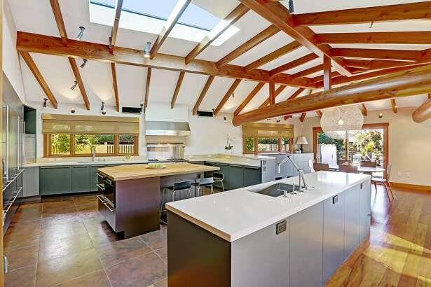 A skylight rests above a kitchen island topped with a maple butcher's block.