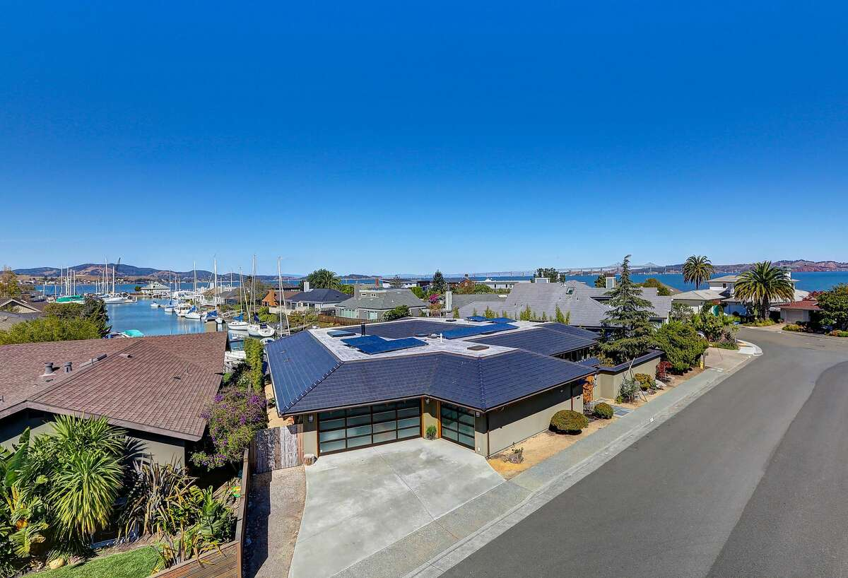 225 Martinique Ave. is a four-bedroom in Tiburon built in 2008. The home sits on bedrock and looks down the length of the channels.