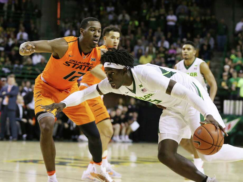 Baylor forward Johnathan Motley, right, drives on Oklahoma State forward Cameron McGriff, in the second half of an NCAA college basketball game, Saturday, Jan. 7, 2017, in Waco, Texas. Baylor won 61-57. (AP Photo/Rod Aydelotte) Photo: Rod Aydelotte, FRE / FRE36102 AP