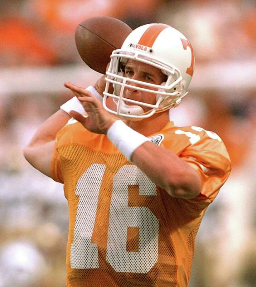 FILE--University of Tennessee quarterback Peyton Manning throws during warm-ups before playing UCLA on Sept. 7, 1996, in Knoxville, Tenn. From the national rankings to the media demands to the long line of students waiting for tickets, everything about next weeks's Tennessee-Florida game is bigger than usual. (AP Photo/Mark Humphrey) Photo: MARK HUMPHREY, Staff / AP