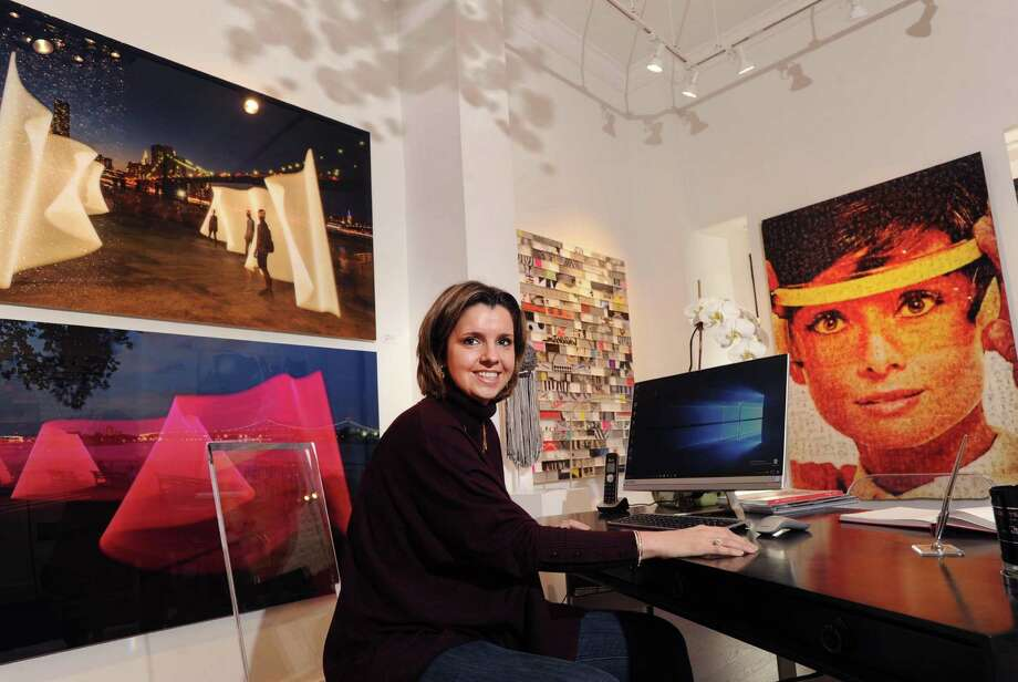 Aida Clement in the Gilles Clement Gallery she owns with her husband Gilles Clement in Greenwich, Conn., Friday, Jan. 6, 2017. Here Aida Clement sits at her desk surrounded by the contemporary artwork that the gallery specializes in. Photo: Bob Luckey Jr. / Hearst Connecticut Media / Greenwich Time